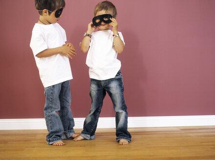 Two little boys wearing black eye masks - FSF00985