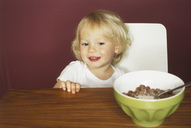 Portrait of smiling little boy at breakfast table - FSF00988
