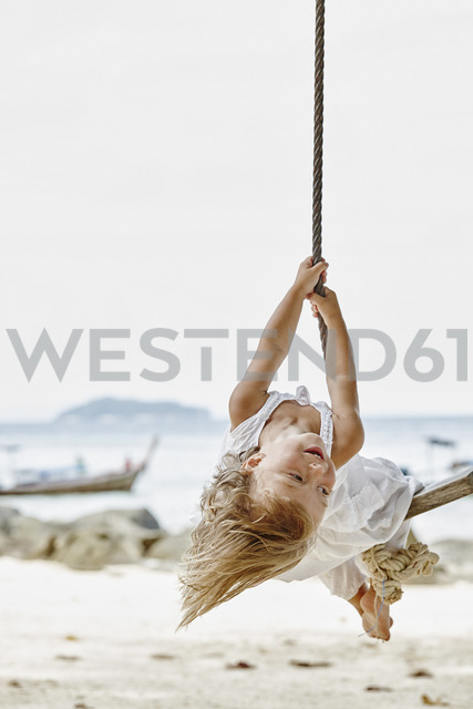 Thailand, Phi Phi Islands, Ko Phi Phi, happy little girl on a rope swing on the beach - RORF01109