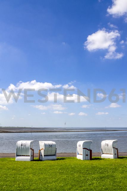 Germany, Schleswig-Holstein, Husum, hooded beach chairs - PUF01173