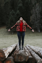 Young woman balancing on logs - OCAF00094