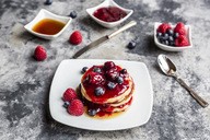 Pancakes with red fruit jelly, maple sirup, raspberry and blueberry - SARF03504