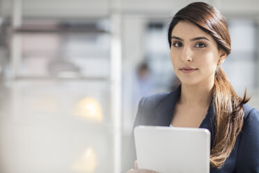 Portrait of young businesswoman with tablet in office - ZEF14916