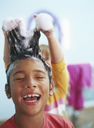 Portrait of laughing little boy with foam in his hair - FSF00991