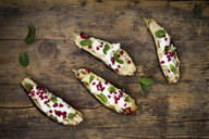 Filled aubergine, couscous, yogurt sauce, mint and pomegranate seeds - LVF06647