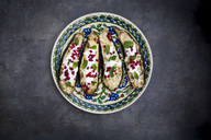 Filled aubergine, couscous, yogurt sauce, mint and pomegranate seeds - LVF06650