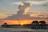 USA, Florida, Naples, view to Naples Pier with crowd enjoying sunset - SHF02001