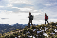 Austria, Tyrol, young couple hiking in the mountains - UUF12540