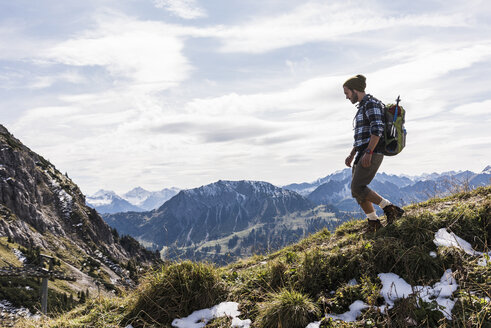 Austria, Tyrol, young man hiking in the mountains - UUF12543