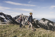 Austria, Tyrol, young couple hiking in the mountains - UUF12546
