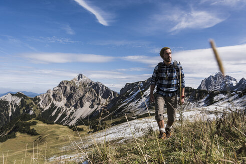 Austria, Tyrol, young man hiking in the mountains - UUF12549