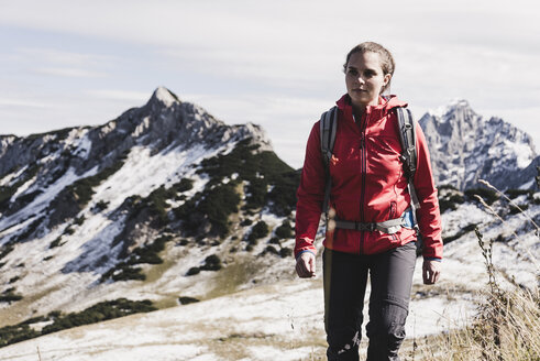 Austria, Tyrol, young woman hiking in the mountains - UUF12552