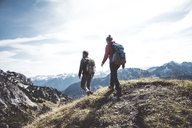 Austria, Tyrol, young couple hiking in the mountains - UUF12558