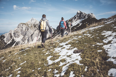 Austria, Tyrol, three hikers walking in the mountains - UUF12585