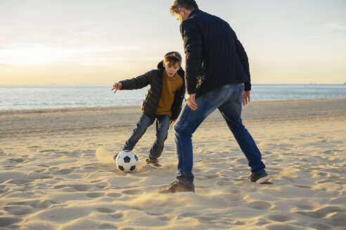 Father and son playing football on the beach - EBSF02041