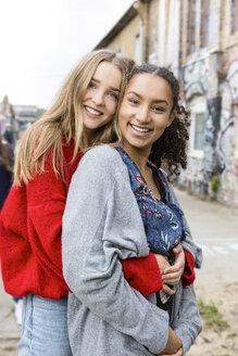 Germany, Berlin, portrait of two happy girlfriends - OJF00232