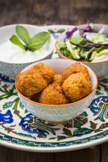 Falafel, salad, red and white cabbage, yogurt sauce with mint - LVF06656