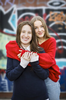 Germany, Berlin, portrait of two happy female friends - OJF00235