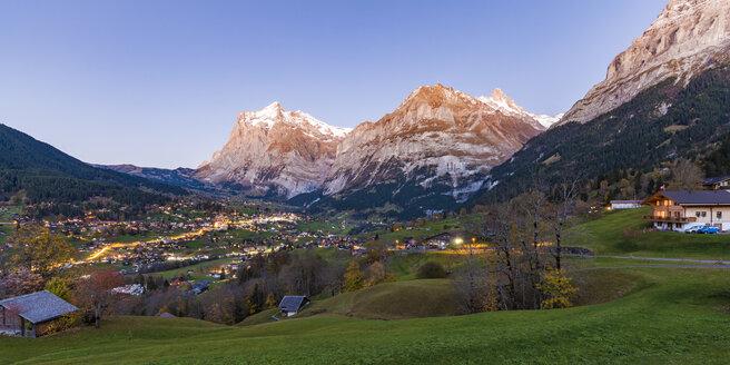 Switzerland, Bern, Bernese Oberland, holiday resort Grindelwald, Wetterhorn, Schreckhorn and Eiger in the evening - WDF04408