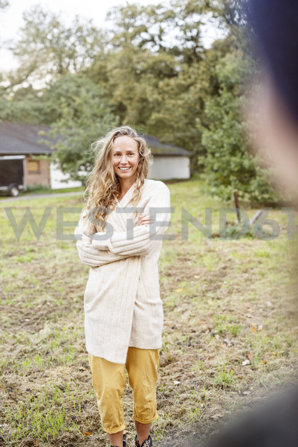 Portrait of smiling blond woman in rural landscape - PESF00906