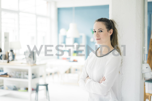 Portrait of smiling young woman in a loft - MOEF00719
