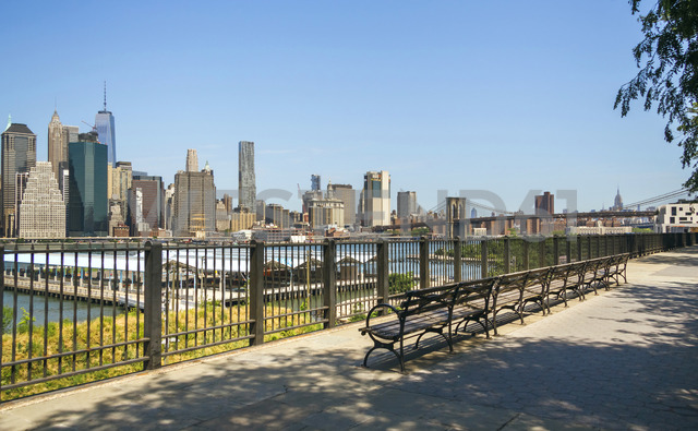 USA, New York, Brooklyn, Skyline of Manhattan from Brooklyn with benches in foreground - DAPF00867