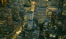 USA, New York, Manhattan, high-rise buildings at night - DAPF00882