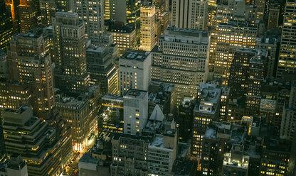 USA, New York, Manhattan, high-rise buildings at night - DAPF00882