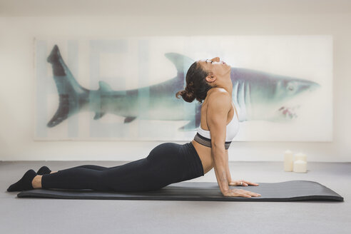 Woman practicing yoga on mat - ASCF00786