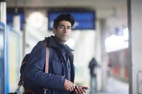 Portrait of man waiting on platform - SGF02169