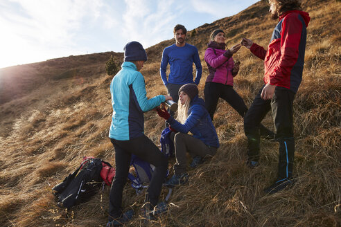 Friends hiking in the mountains having a break - PNEF00454