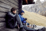 Couple having a break at mountain hut - PNEF00472