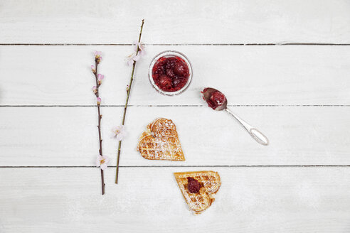 homemade waffels with cherries, waffel hearts with cherry blossom decoration - GWF05422