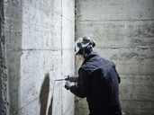 Construction worker drilling, electric drill - CVF00100