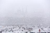 Germany, bavaria, wuerzburg, City view and snowfall - NDF00741