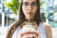 Portrait of teenage girl drinking milkshake - WPEF00030
