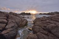 Italy, Sardinia, Cala Rossa, Costa Paradiso, rocky coast at Cala Rossa at sunset - RUEF01820