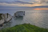 Great Britain, England, Dorset, Jurassic Coast, Isle of Purbeck, Old Harry Rocks, rocks at sunrise - RUEF01823