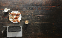 Breakfast table with laptop, top view - FMKF04782