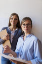 Female architects working on a project, looking confident - VABF01491