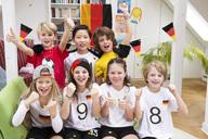 Group of kids watching soccer world championship, cheering - NEKF00011