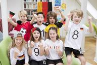 Group of kids watching soccer world championship, cheering - NEKF00014