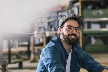 Portrait of smiling man in workshop - UUF12695