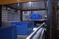 Blue boxes on conveyor belt - CVF00118