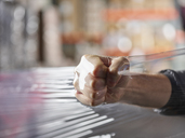 Fist inside plastic foil testing stability - CVF00136