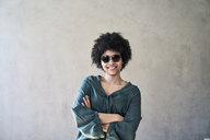 Portrait of smiling young woman wearing sunglasses - FMKF04820