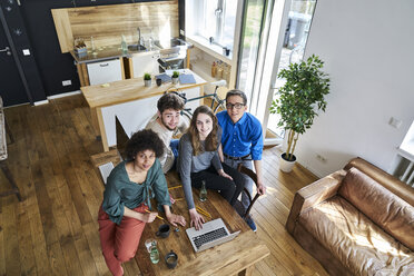 Elevated view of smiling coworkers in office - FMKF04829