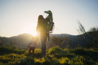 Spain, Barcelona, grandmother with granddaughter during a hike at sunset - GEMF01877