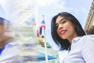 Thailand, Bangkok, portrait of smiling businesswoman in the city - WPEF00078