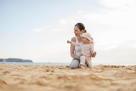 Happy mother with little daughter on the beach - DIGF03255